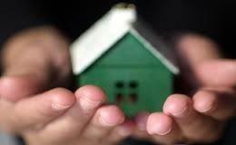 Green home in hands